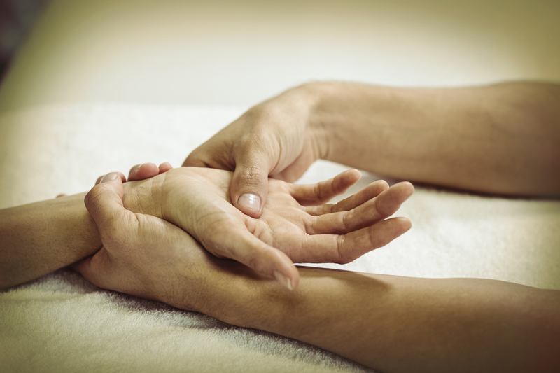 Therapist in Arizona massaging the hands